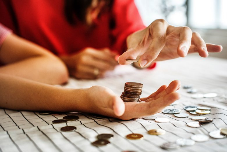 Two people counting change