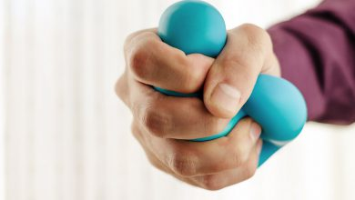 Man's hand squeezing a stress ball