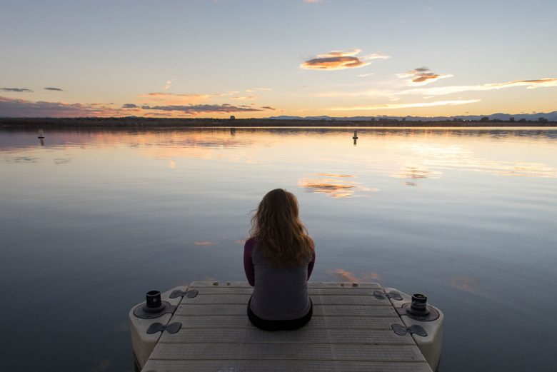 Woman looking out over a lake