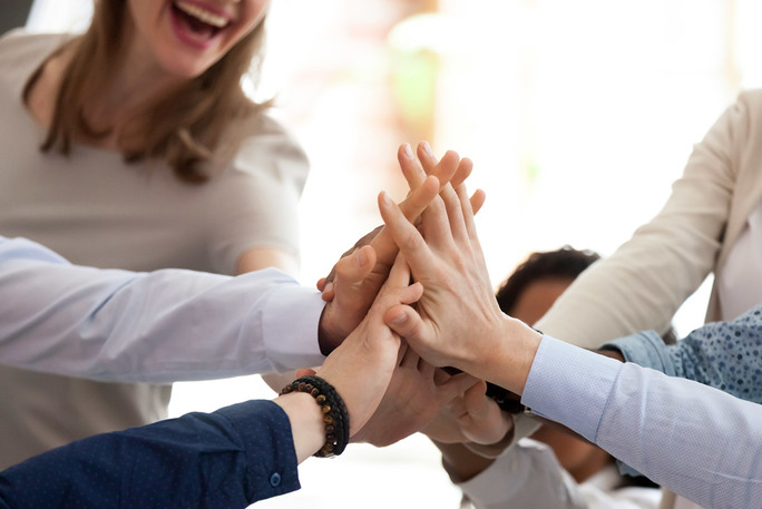 Group of employees giving each other high-five
